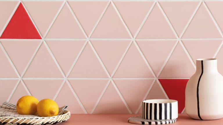 Pink triangular tiles in a kitchen