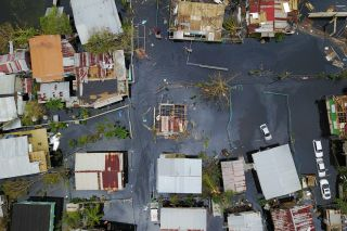 An aerial view of the flooded neighborhood of Juana Matos in Puerto Rico, on Sept. 22, 2017, in the aftermath of Hurricane Maria.