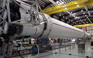Falcon 9 undergoing flight hardware final integration at Cape Canaveral.