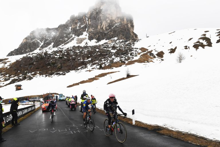 Hugh Carthy, João Almeida and Giulio Ciccone battling up the snow covered Passo Giau on stage 16 of the Giro d'Italia 2021