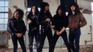 Thrash metal legends Anthrax standing inside an empty warehouse
