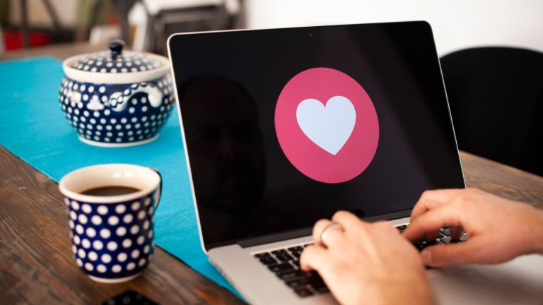 Apple, A laptop screen with a heart emoji is seen in this photo illustration on October 15, 2018 in Warsaw, Poland