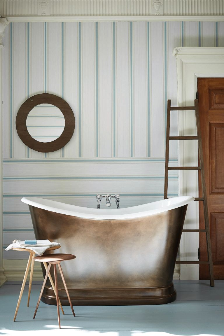 Horzintal and vertical striped wallpaper with white and green, copper bath tub and blue wooden flooring