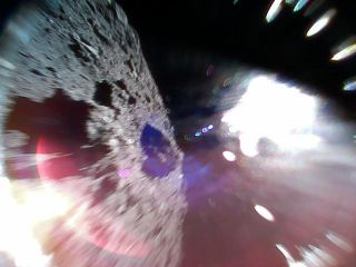 This spectacular photo shows the view from asteroid Ryugu from the Minerva-II1A rover during a hop after it successfully landed on Sept. 21, 2018. The probe is one of two that landed on Ryugu from the Japanese Aerospace Exploration Agency's Hayabusa2 spac