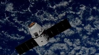 A SpaceX Dragon cargo ship approaches the International Space Station to delivery nearly 3 tons of supplies on July 2, 2018 in this view from a station camera. It is the Dragon's second trip to the space station.