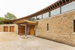A Curved Oak Frame Home with Striking Entrance