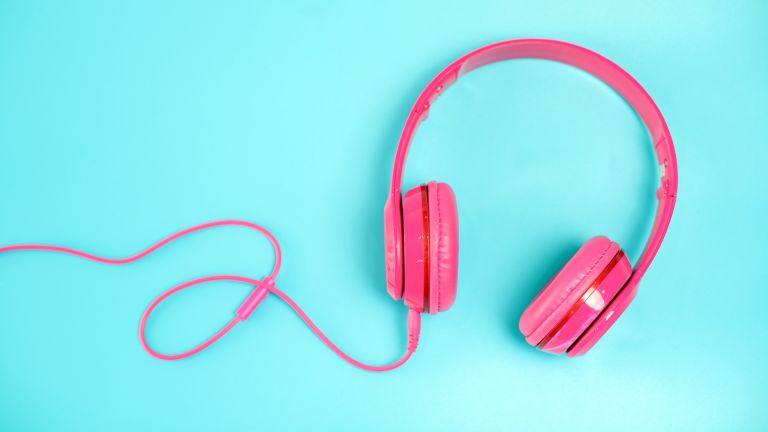 pink headphone on light Blue background,vintage or pastel concept