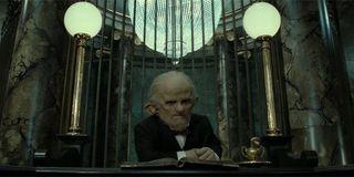 A goblin sitting at Gringotts Wizarding Bank
