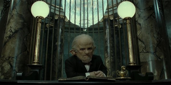 A goblin sitting at Gringotts Wizarding Bank