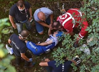 Remco Evenepoel fell about 10 metres into a river bed