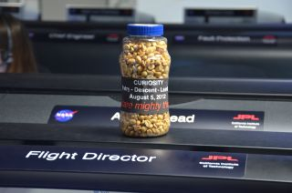 "A bottle of peanuts, labeled in part ""dare mighty things,"" is ready and waiting for the landing of NASA's Curiosity rover on Mars on Aug. 5, 2012."