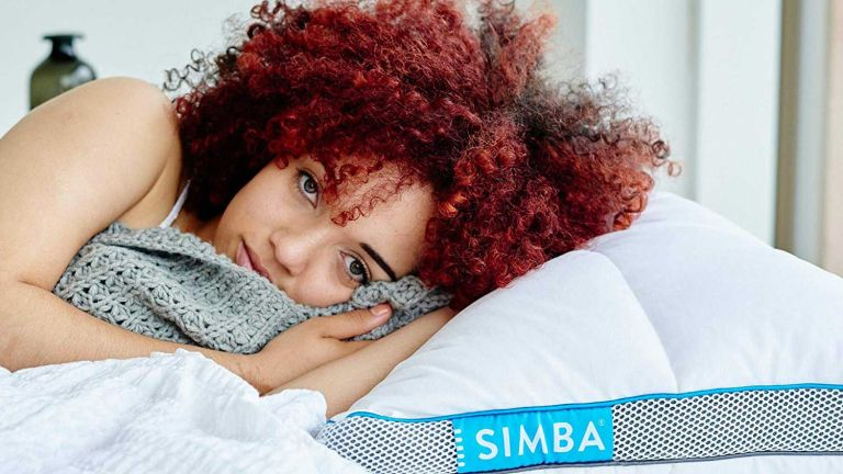 Best pillow for side sleepers: girl laying on Simba Hybrid pillow