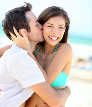 Happy couple kissing during summer