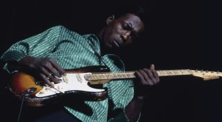Buddy Guy performs live at the American Folk Blues Festival tour in London in October 1965.