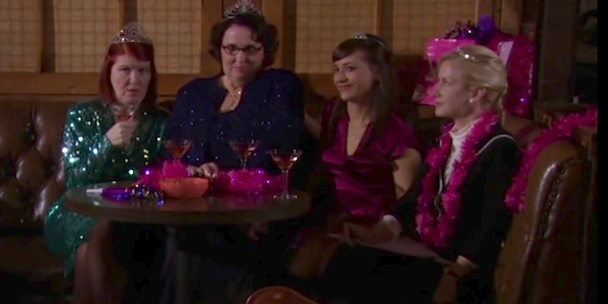 the four bachelorettes seated at a table in Threat Level Midnight
