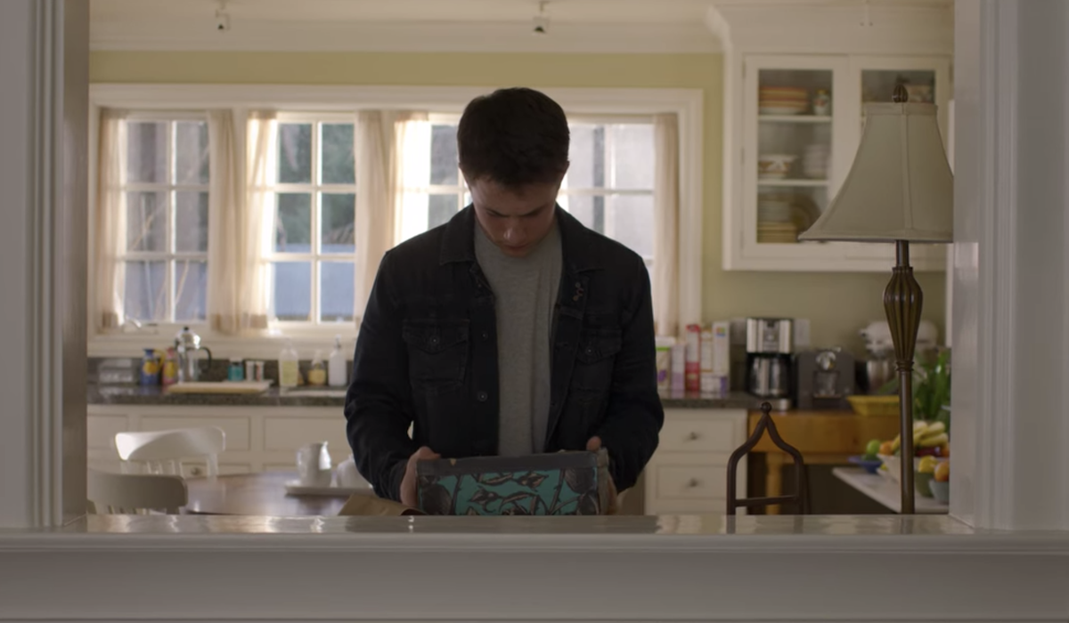 Dylan Minnette as Clay Jensen with Hannah Baker's tapes in 13 Reasons Why finale