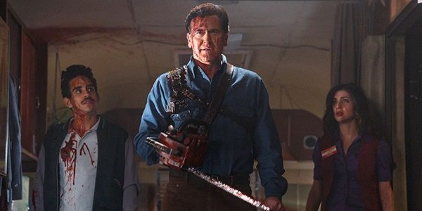 Ash vs Evil Dead Bruce Campbell proudly stands blood splattered between two companions
