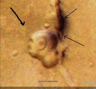 A Martian surface feature, as seen on the Google Mars database, that one man says looks like the profile of Mahatma Gandhi.