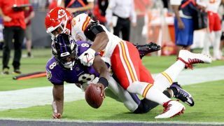 Lamar Jackson #8 of the Baltimore Ravens dives into the end zone for a touchdown past the tackle of Michael Danna #51 of the Kansas City Chiefs during the fourth quarter at M&T Bank Stadium on Sept. 19, 2021 in Baltimore, Maryland.