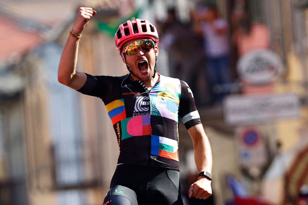 Team EF Education rider Italys Alberto Bettiol celebrates as he crosses the finish line to win the 18th stage of the Giro dItalia 2021 cycling race 231km between Rovereto and Stradella on May 27 2021 Photo by Luca Bettini AFP Photo by LUCA BETTINIAFP via Getty Images