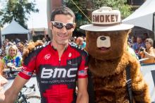 Smokey the Bear pays his respects to George Hincapie in Golden, Colorado prior to the BMC American's last road race in the professional peloton.
