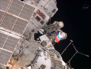 Russian Flag Waves Outside the International Space Station
