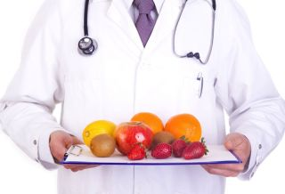A doctor holds a tray of fruit