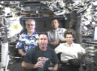 Shuttle Crew Moves Cargo, Anticipates Extra Flight Day