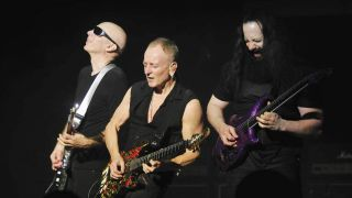 Joe Satriani, Phil Collen and John Petrucci jamming on stage in New York