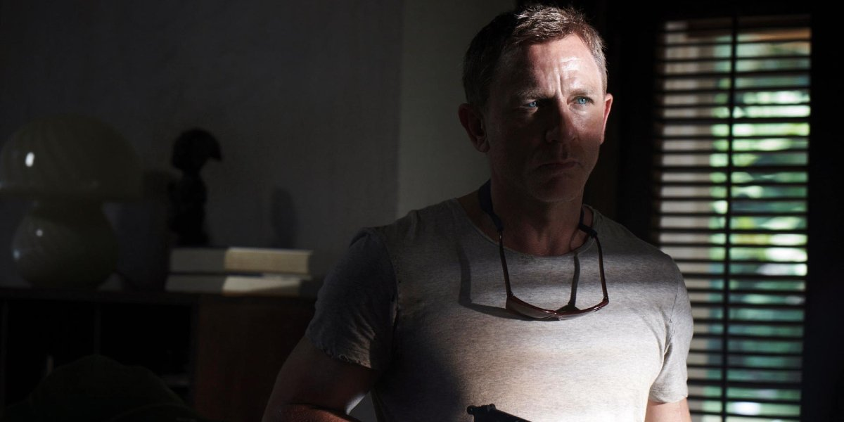 No Time To Die Daniel Craig cautiously arms himself in the shadows