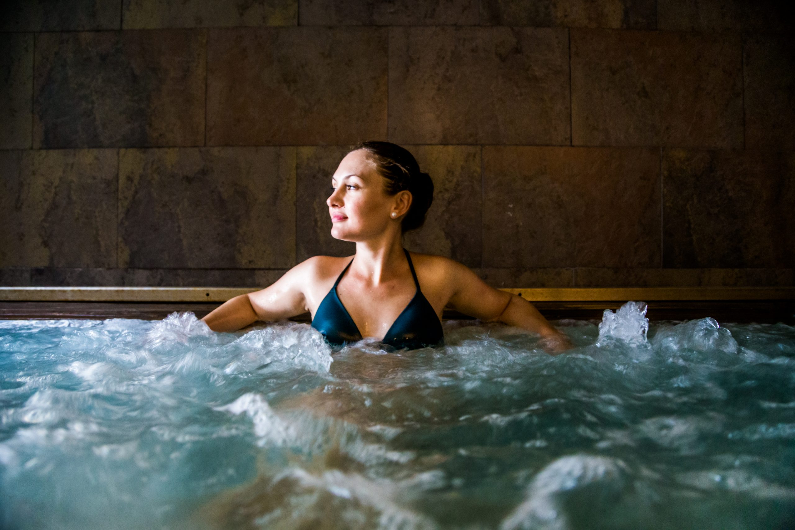 woman in a pool at a spa