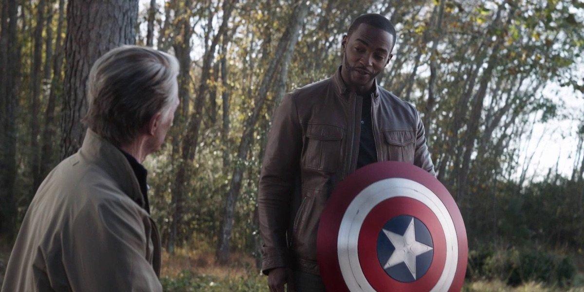 Anthony Mackie as Falcon / Sam Wilson holding Captain America shield