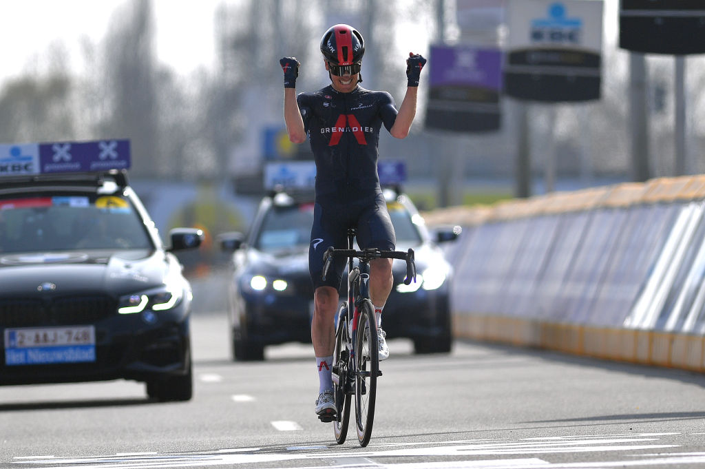 WAREGEM BELGIUM MARCH 31 Arrival Dylan Van Baarle of Netherlands and Team INEOS Grenadiers Celebration during the 75th Dwars Door Vlaanderen 2021 Mens Elite a 1841km race from Roeselare to Waregem DDV DDV21 FlandersClassic A travers la Flandre on March 31 2021 in Waregem Belgium Photo by Luc ClaessenGetty Images