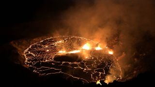 The Kilauea eruption, as seen at dawn local time on Sept. 30. Lava fountains are spurting out at multiple fissure locations at the base and west wall of the crater, and a lava lake is growing within Halema'uma'u.