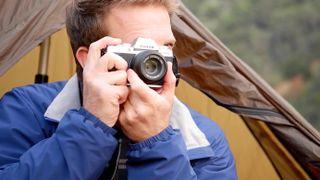 Man holding best camera Fujifilm