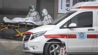 Medical staff transfer patients to Jin Yintan hospital on Jan. 17, 2020, in Wuhan, China, where an outbreak of a new coronavirus has sickened hundreds of people.