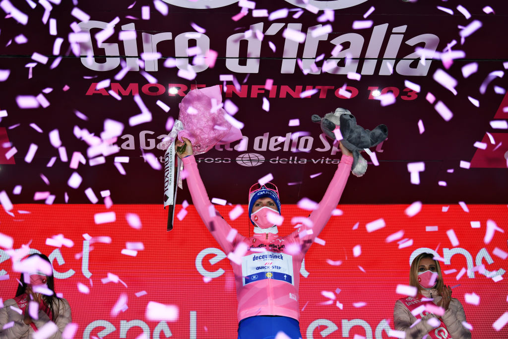 MADONNA DI CAMPIGLIO ITALY OCTOBER 21 Podium Joao Almeida of Portugal and Team Deceuninck QuickStep Pink Leader Jersey Celebration Flowers Miss Hostess during the 103rd Giro dItalia 2020 Stage 17 a 203km stage from Bassano del Grappa to Madonna di Campiglio 1514m girodiitalia Giro on October 21 2020 in Madonna di Campiglio Italy Photo by Tim de WaeleGetty Images