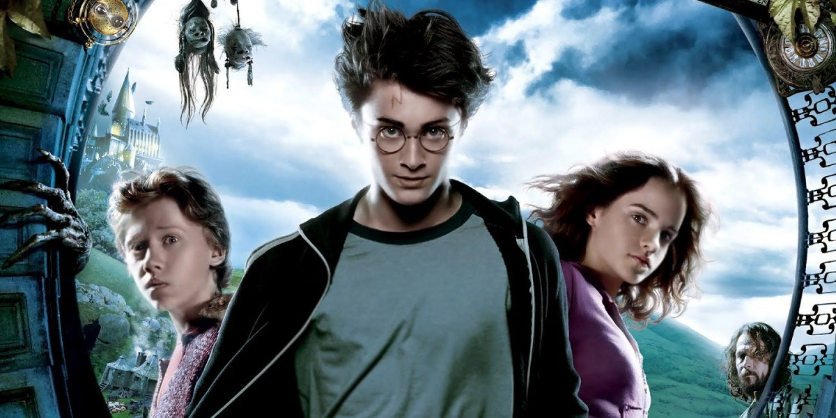 Harry Potter and the Prisoner of Azkaban Ron, Harry, and Hermione lined up for the poster, with Sirius in the background