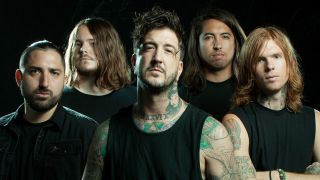 Metalcore band Of Mice & Men standing against a black background
