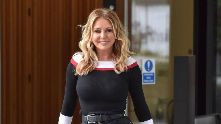 Carol Vorderman looks gorgeous in black leather trousers