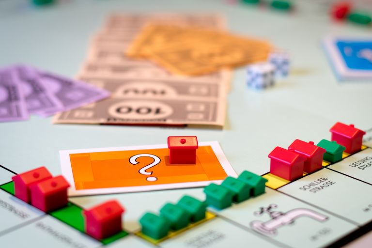 toy houses on a Monopoly board