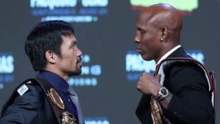 Manny Pacquiao (L) and WBA welterweight champion Yordenis Ugas face off during a news conference at MGM Grand Garden Arena