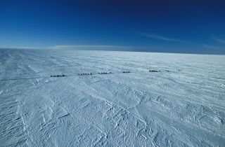 Researchers on their way to Dome C near the Concordia station on the Antarctic Plateau in Antarctica.