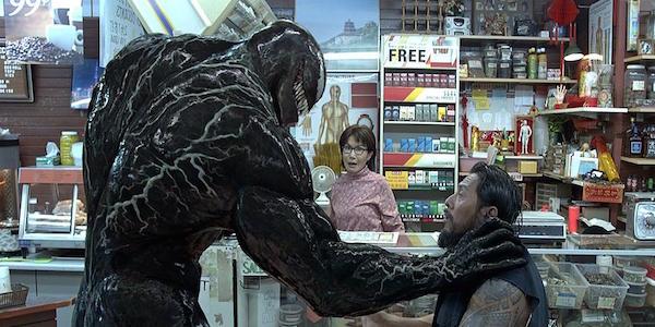 Venom grabs a guy 2018 movie