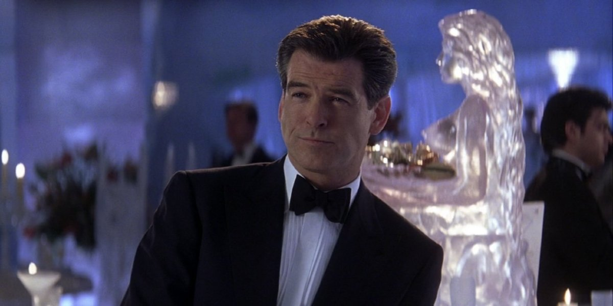 Pierce Brosnan in a tuxedo with a sly smile in Die Another Day.