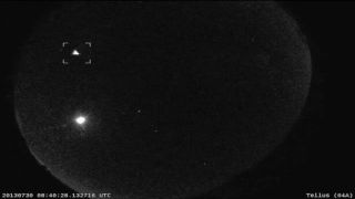 This still image from a NASA video shows a brilliant fireball caused by an early Perseid meteor on July 30, 2013 as seen by NASA's all-sky camera network.
