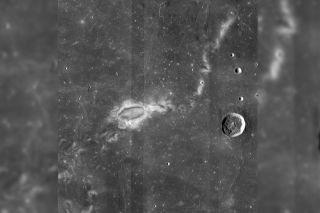 The Reiner Gamma lunar swirl is seen decorating the moon's surface, an image taken with NASA's Lunar Reconnaissance Orbiter.