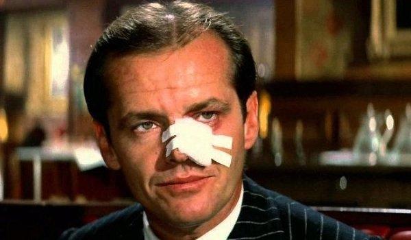 Chinatown Jake Gittes bandaged but smiling