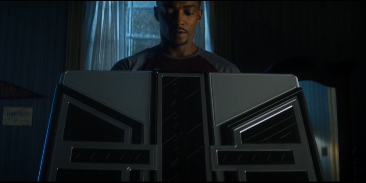 Sam Wilson looks at new suit in The Falcon And The Winter Soldier