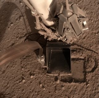 "The InSight mars lander's burrowing heat probe, known as ""the mole,"" has been stuck in the red dirt since February 2019. But it moved a bit recently, raising hopes that it may eventually be able to get down to its target depth."